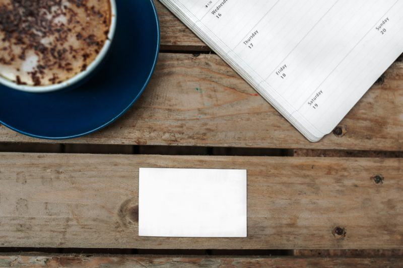 Blank Business Card on a Table with a Latté & Dayplanner